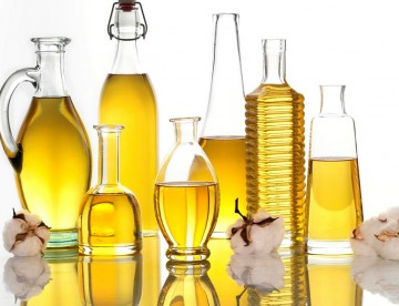 Different sized vials of Cottonseed Oil